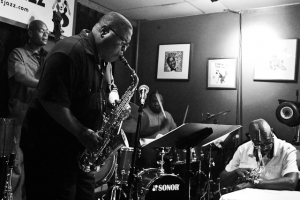 Bruce Williams, saxophone, Herman Burney, bass, and Howard Franklin, drums with Paul Carr listening